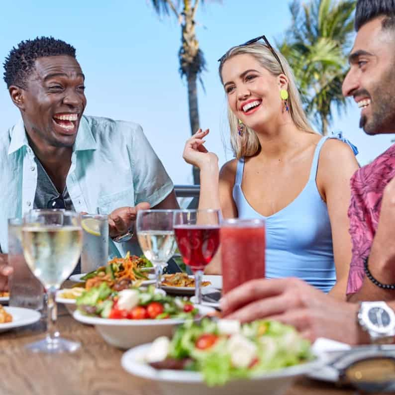 Three people having lunch and drinks at Suncoast Casino