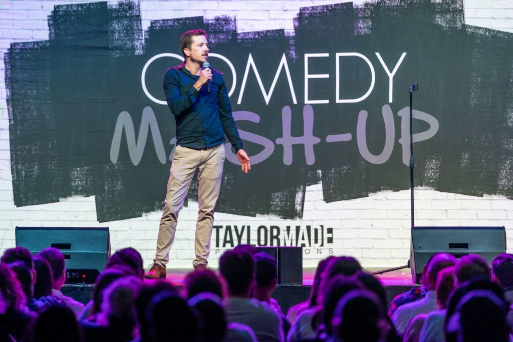 Comedian performing at the Comedy Mash-up event at The Globe