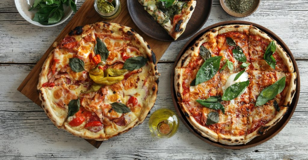 Two pizzas on display from the Lupa