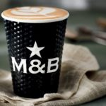 Cappuccino in a Mugg and Bean cup