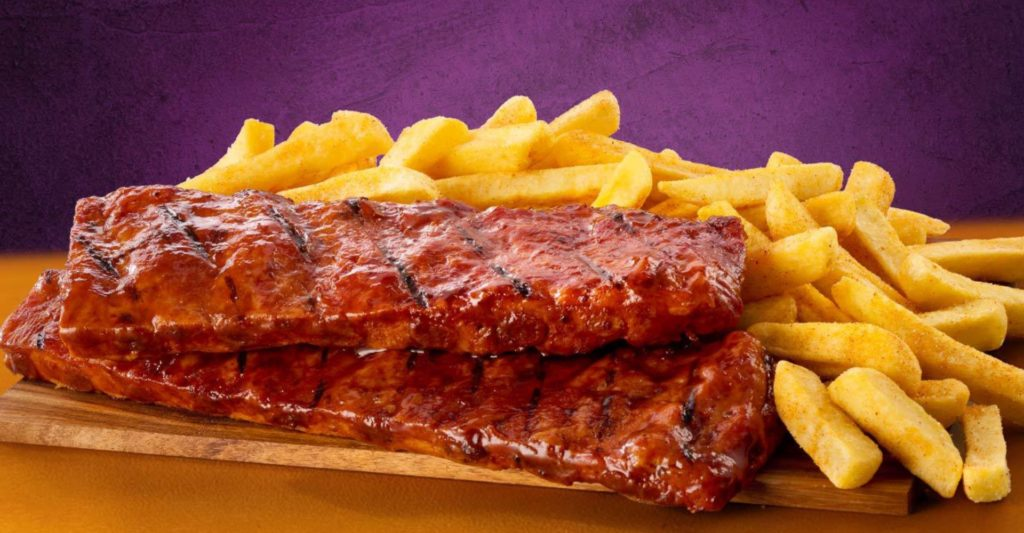 Steers ribs and chips with a purple background