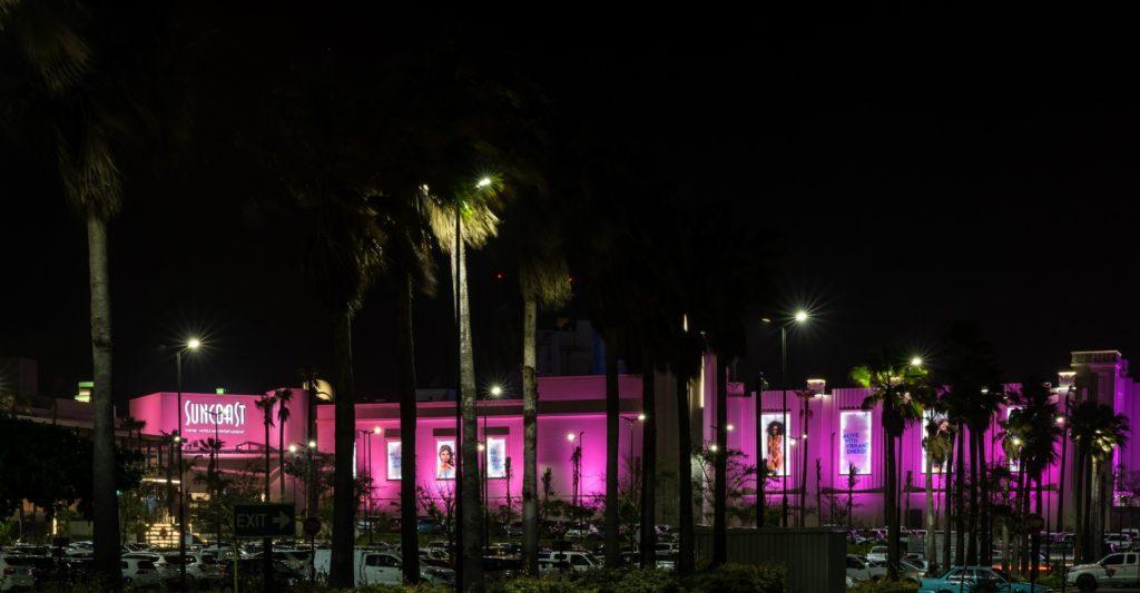 Suncoast Casino with pink exterior lighting at night