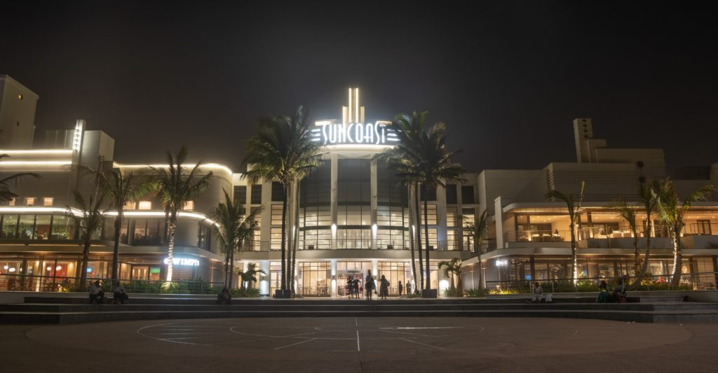 Suncoast Casino entrance lit up at night with yellow lights