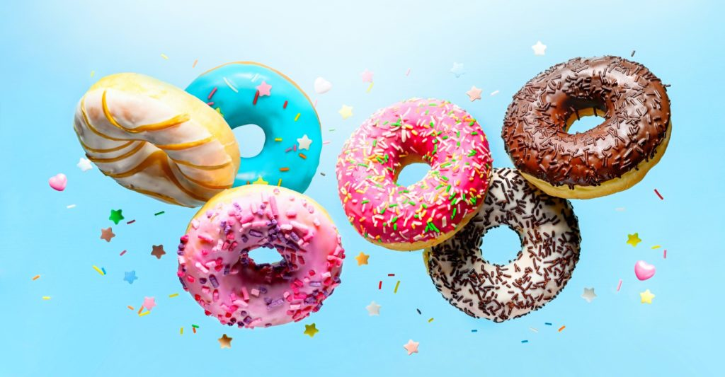 Colourful donuts displayed landscape banner with a blue background