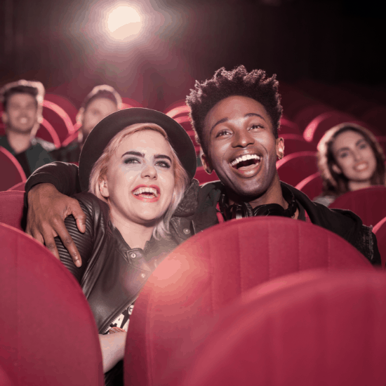 Couple at the cinema laughing