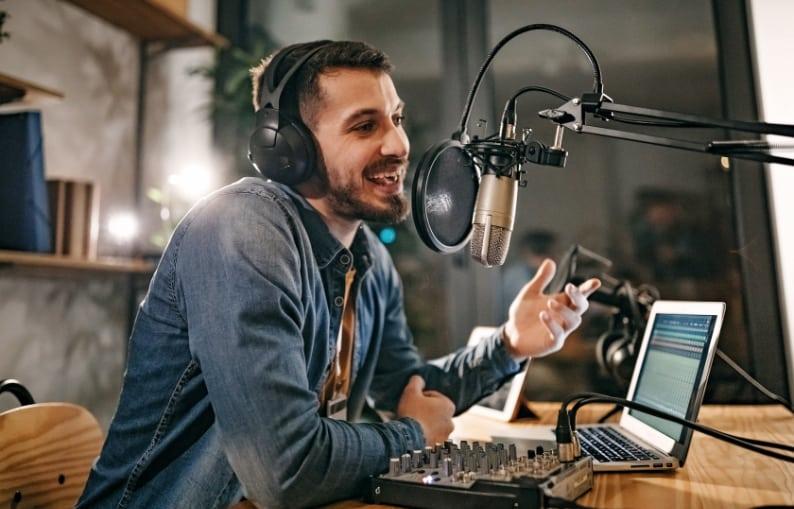 Guy recording at the radio station